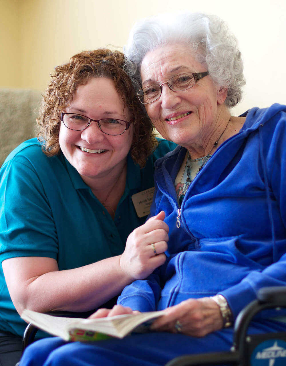 caregiver and senior enjoying smiles