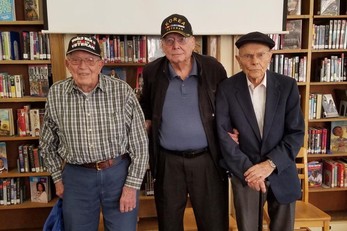 Group photo of three U.S. veterans